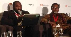 Mahmood Ali-Balogun seated beside panel host Professor Aboubakar Sanogo